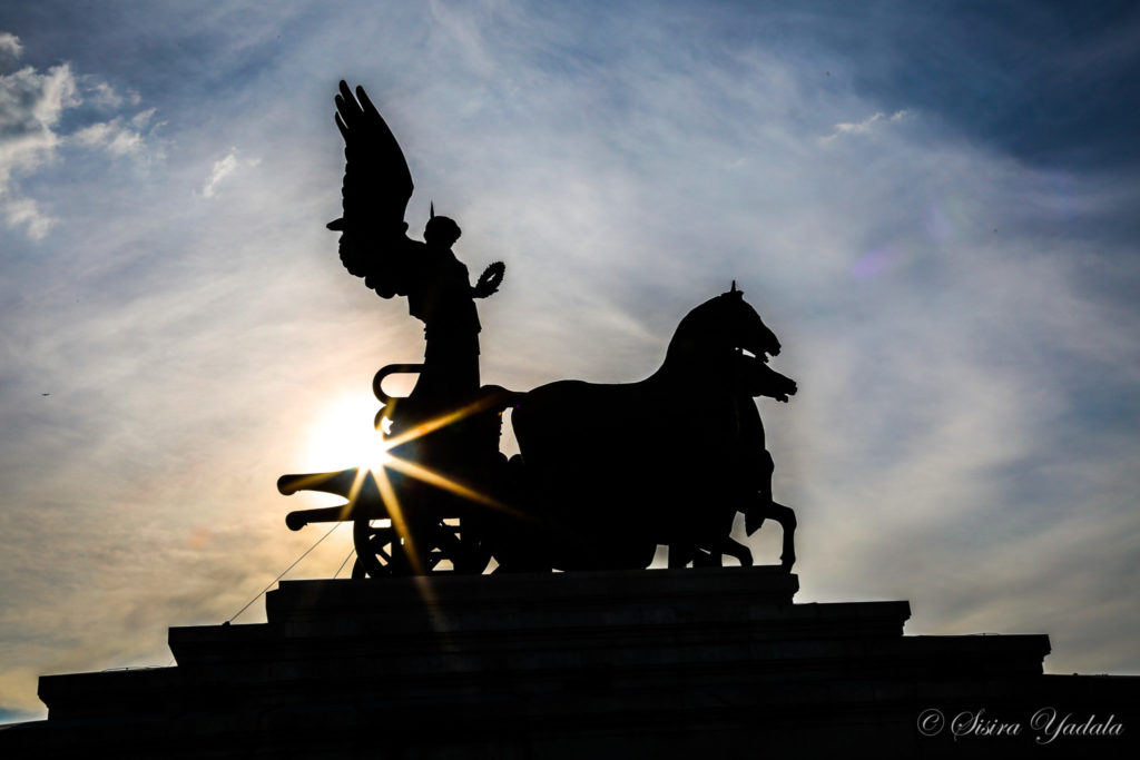 Goddess of Victory statue silhouetted in the sun