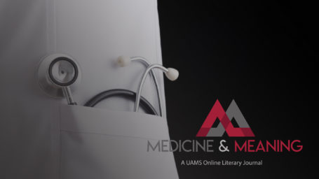 Medicine and Meaning Logo superimposed over a close up of a stethoscope sitting in the pocket of a doctor's white coat