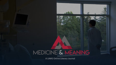 Photo of a doctor looking out a window in a patient room. The Medicine and Meaning logo is superimposed.